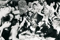 """Josephine Baker celebrating the success of the play """"Vent de folie"""" (Crazy Nights) with her cast - 1931"""