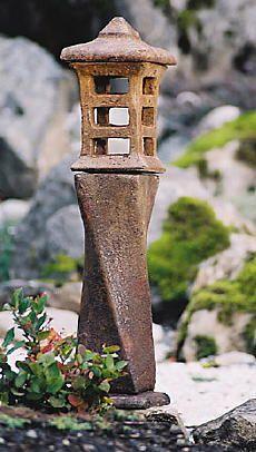 Small japanese stone garden lantern will brighten your for Garden decking ornaments
