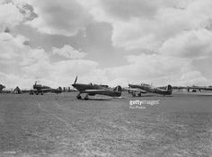 """RAF Hawker Hurricanes N2458 and N2459 ready for take-off at Hawkinge Airport in Kent, 29/08/40.  Hurricane N2458 is the left one. This is the only photo showing a plane piloted by Rodoplphe de Hemricourt de Grunne in the Battle of Britain,14/08/1940.  Sources: """"The Battle of Britain Then and Now"""" (Winston Ramsey, ed. 1980, p. 106, 107, 110 et 111), The Imperial War Museums (HU 69116), The National Archives (AIR 27/360/24) and Getty Images (http://www.gettyimages.be/license/107978856)."""