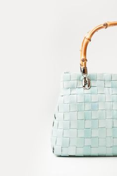 The Alba - Our pale blue soft woven leather bag, with feature double wooden handles - A summer favourite.