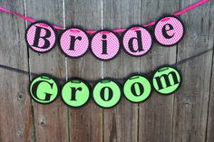 "Hot pink and lime green wedding banner decoration ""Bride,"" ""Groom."" Could change the colours slightly to match the ones you want"