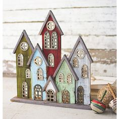 Our beautiful Multicolor Recycled Wood Village Statue will make you feel right at home! We think it will look best perched on your living room bookcase. Christmas Home, Christmas Crafts, Christmas Decorations, Holiday Decor, Wooden Art, Wooden Crafts, Small Wooden House, Miniature Houses, Recycled Wood