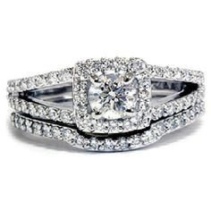 And there is my promise ring except mine has a princess cut pink sapphire in the middle! Diamond with halo, split shank engagement ring w/ band wedding ring set.