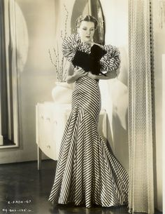 """striped gown with """"Letty Lynton"""" shoulders designed by RKO costume designer Bernard Newman  - from the 1934 film Roberta"""