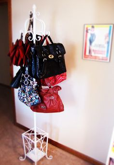 If you love to admire your pocketbooks when not in use, try this idea (which also prevents you from tripping over them). See more at Casee Marie »   - GoodHousekeeping.com
