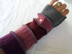 Inspired and instructed by Katwise, I cut up recycled wool sweaters and sew them together in a new way. These purple, pink, maroon, and gray cozies add just the right touch of warmth to cool days and evenings, so they are good to have on hand as the weather changes.