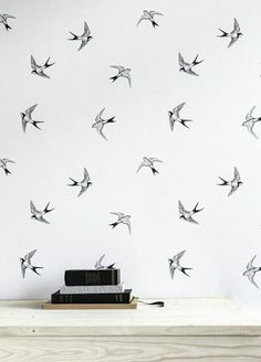 The bird pattern is an interesting type of wallpaper. I like how it's different.