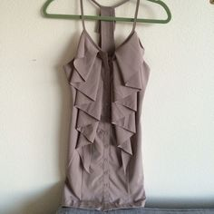NWT AKIRA taupe cascade ruffle tank button dress LOVE this dress but purchased about 5 years ago and have yet to wear. Taupe color. Originally purchased to wear to a wedding. Ruffles down the front and back. Button up. Has belt loops made of braided thread on the sides if you wish to wear this with a belt. Has a small tear on the inside near the bottom. Not at all noticeable while wearing and would be fixable for those handy with needle and thread. Priced accordingly. AKIRA Dresses Mini