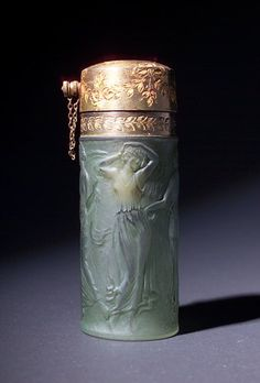 """R. LALIQUE Perfume atomizer, """"Figurines,"""" for Marcas et Bardel, c. 1926, in clear and frosted glass with green patina, in original gilt metal mounts. Molded R. LALIQUE MADE IN FRANCE"""