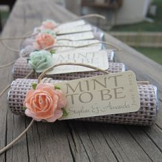 Some of our favorite things wrapped up in one! Peach and Mint rosettes and burlap!
