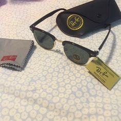 Black and gold Ray Ban club masters Brand new! Super cute and still has the tags attached. They are 51 mm. They come with the case and cleaning cloth as well. Looks great on anyone! Ray-Ban Accessories Sunglasses