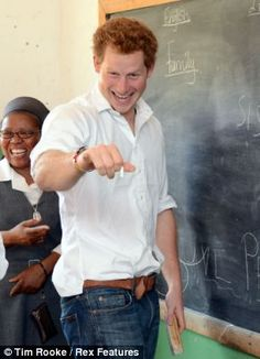 Prince Harry charms children in classroom visit to Lesotho charity and even gets an 'official' chalk portrait | Mail Online