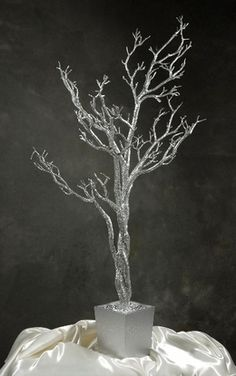 54.00 SALE PRICE! Make a dramatic display with this dazzling artificial silver tree in a silver wood pot. The glittering silver tree is 4' tall with wired br...
