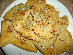 Ravioli alla zucca con fonduta di gorgonzola e noci