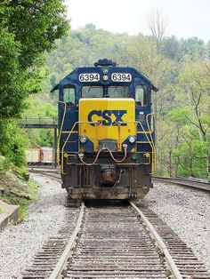 The bridge can be seen in the background!!  How many times have the grandchildren enjoyed walking across the train tracks and the river?  CSX EMD GP 38-2 is waiting for an assignment at Spruce Pine, North Carolina, May 2009 | Flickr - Photo Sharing!