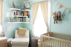 Cute nursery....I like the idea of hanging a basket on the wall to store stuffed animals