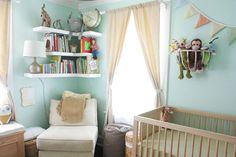 Cute nursery....I like the idea of hanging a basket on the wall to store stuffed animals