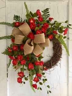 Our gorgeous red petunia wreath is full of beautiful artificial petunias, lush greenery, fern, and natural burlap ribbon. This wreath is handcrafted using a 14 inch grapevine wreath base and measures approximately 25 inches from tip to tip.  This wreath is handcrafted and made to order so please allow approximately 10-14 days before shipping.  *All of our designs can be used outdoors, but I would recommend an overhang to protect them from sun, rain, and wind damage. MORE WREATH SELECTIONS ►…
