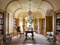 Night Shyamalan's gatehouse work space features white-oak bookcases and a vaulted ceiling with hand-troweled plasterwork; the globe light fixtures are by Remains Lighting, and the antique Swedish desk chair is from Dienst + Dotter Antikviteter. Architectural Digest, Architecture Details, Interior Architecture, Interior And Exterior, Zen, Traditional Office, South Shore Decorating, Home Libraries, Interior Decorating
