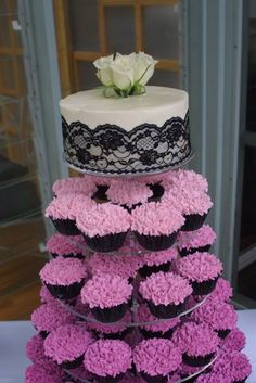 This cupcake tower was both simple, but elegant. The main objective with this wedding tower was to have each tier of cupcakes grow progressively lighter from the bottom tier up to the top cake. I believe this technique is also known as ombre, meaning shading in French.