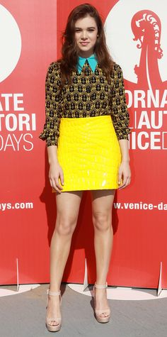 At the Women's Tales photocall, Hailee Steinfeld delivered a chic offbeat look, courtesy of Miu Miu, comprising a teal-collared floral-print blouse tucked into a bright yellow croc mini with nude platforms.