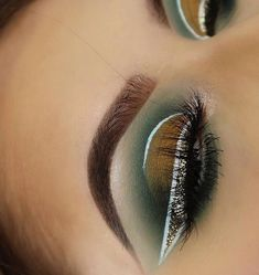 Green, mustard yellow half-cut crease eyeshadow w/ white and glitter liner