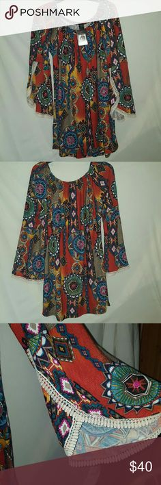 Gorgeous Bo.Ho Tunic or Dress. This is so soft and flowing, you feel so comfy all day, you will love this. Gorgeous fall colors. 31 inches in length. Flared sleeves with crocheted around them. Fits extra large also. Has strech to it. Tops Tunics