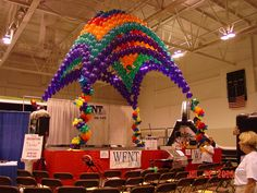 """Stage decor / Balloon Canopy for FOX66 """"Bringing it Home"""" event at Perani Event Center"""