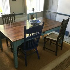 Upcycled modern pine table with painted legs and dark wax top to give a French shabby chic farm house look. Completed with upcycled mismatched chairs with similar colours and fabrics to give an eclectic but coherent feel to the set.