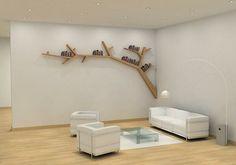 un rayonnage décoratif, une branche d'arbre sur un mur blanc