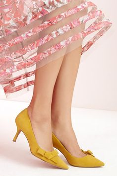 Lush suede mid heel pump in mustard yellow with ladylike bows
