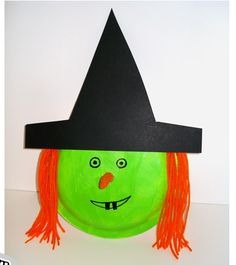 Plate witch with yarn hair. Cute, simple and easy for the kids to do. I think I'll put it on a large popsicle stick so it's even more fun!