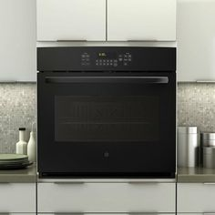 10 must-haves for the luxury kitchen - Yahoo Homesshows a pot filler by stove.  I'd like that