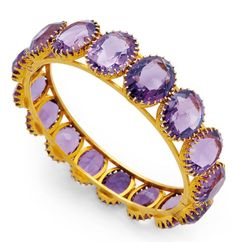 An Antique Amethyst and Gold Bangle Bracelet, circa 1900.  The oval hinged hoop encircled by graduated oval amethysts, mounted in 14k gold, inner circumference 6 1/4 ins, with Garrard box