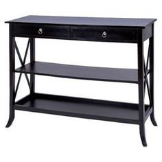 "A lovely canvas for family photos and fresh-cut flowers, this 3-tier wood console table features ring-pull hardware and sides with x-shaped lattices.   Product: Console tableConstruction Material: WoodColor: BlackDimensions: 36.8"" H x 46.8"" W x 16.8"" DCleaning and Care: Wipe with a dry cloth"