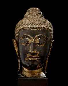 A copper alloy head of Buddha Thailand, Ayutthaya period, 16th century  13 3/4 in. (34.9 cm) high