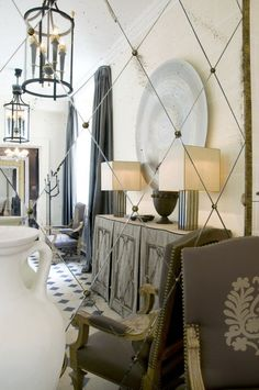 French foyer - antiqued mirror tiles hung on the diagonal...or is that a framed mirror?  I think so.  Either way, I love it!