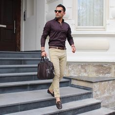 Dark maroon shirt, brown belt, brown watch, khaki pants, loafers