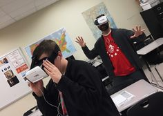 """Boyd County High School teacher William Parker and a 10th grade student immerse themselves in """"One World, Many Stories: Amman Jordan."""" The virtual reality technology makes them feel they are underneath an ancient ruin at the Citadel in Amman."""