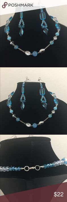 Necklace and earring set Beaded white and blue crystal cut beaded necklace and earring set. Necklace is accented with a silver color chain. Very nice set. hand designed Jewelry Necklaces