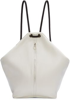 Unstructured brushed leather backpack in white. Rope shoulder straps in black featuring eyelet accents. Zippered pocket at bag face. Zip closure at main compartment. Suede interior in black. Silver-tone hardware. Tonal stitching. Approx. 18