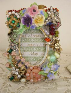 """Need to show this to Liz Hubbuch! Would be a cute idea to frame a wedding photo with some of the """"meaningful Brooches"""" from her bouquet!"""