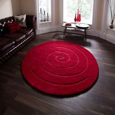 the BIG rug store Spiral Round Red Rug - Love these beautiful Spiral circular rugs. Here in red, a wonderful wool pile rug. And with free delivery within the UK mainland (see terms). Small Round Rugs, Circular Rugs, Circle Rug, Affordable Rugs, Machine Made Rugs, Red Rugs, Modern Rugs, Modern Carpet, Contemporary Rugs