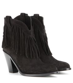 Saint Laurent - New Western fringed suede leather ankle boots - These ankle boots from Saint Laurent are topping our list of must-haves for this fall. Covered in black suede and trimmed with fringe, slip these boots on for all your casual urban day looks. We think these look especially good with bare legs and a leather skirt. seen @ www.mytheresa.com