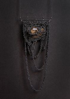 Necklace | Julia Berg. A herkimer diamond caught in a crochet handmade net of oxidized sterling silver chains