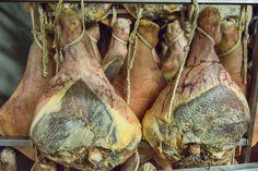 Hanging legs of Prosciutto di Modena