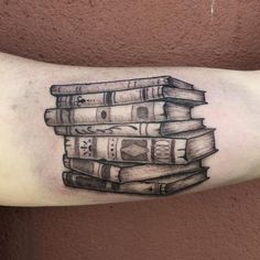 A black and gray stack of books tattoo #literarytattoos http://writersrelief.com/