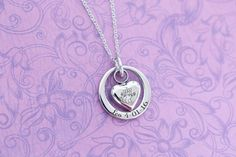 The perfect gift to commemorate the loss of your furry friend. Pendant is made from stainless steel and comes with an 18 stainless chain. Please specify color preference in the drop down menu. There are 4 spots for personalization on this pendant:  Front Heart (up to 10 letters, or one large monogram initial) Back Heart (Same as above) Front Ring (Up to 20 letters) Back Ring (Same as above)  Please choose number of engraving points from the drop down menu and specify what and where you would…