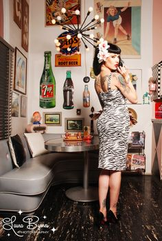 Not only do I love the dress (Pin Up Girl Clothing, Vamp Dress), but I also love the atmosphere. Beautiful 1950s diner feel. Love the wall art!