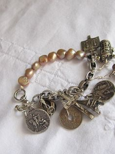 vintage repurposed assemblage charm bracelet with sterling silver medals and crucifix by atelier paris
